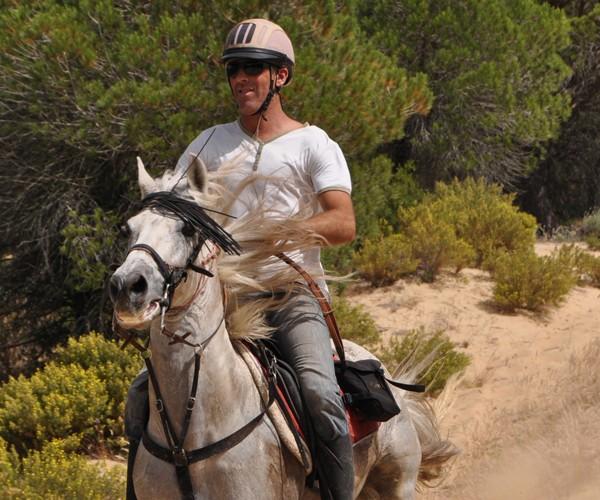 Jose riding Diego down the Firebreak Image